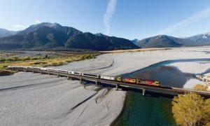 Tranz Alpine Train crossing braided rivers in New Zealand