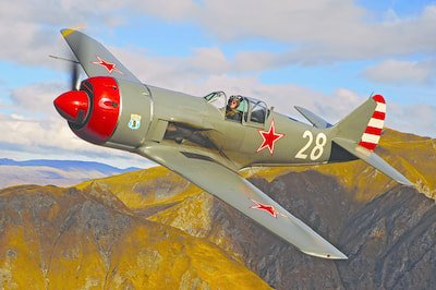 Lavochkin La-9 flying over the mountain tops at Warbirds Over Wanaka