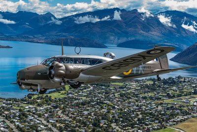 aerial shot of plane flying over in Warbirds of Wanaka Airshow