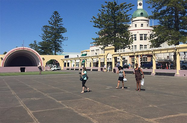 People walk across the pavement at the Napier Soundshell