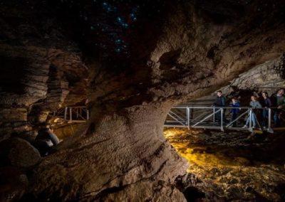 Group walking through the Te Anau-au Caves