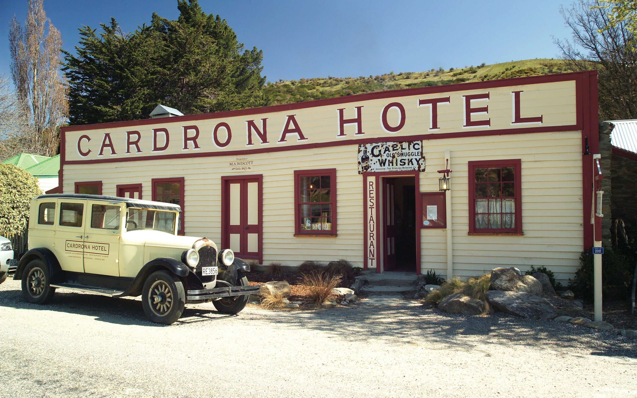 Cardrona Hotel with Cardrona Car parked in front