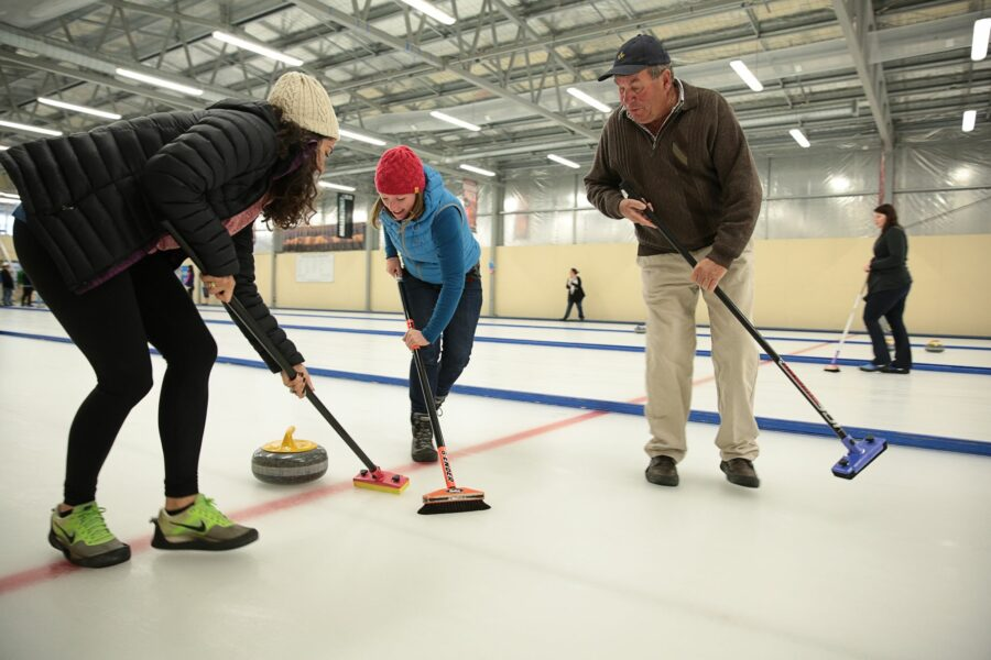 Naesby International Curling, people having a go on the ice