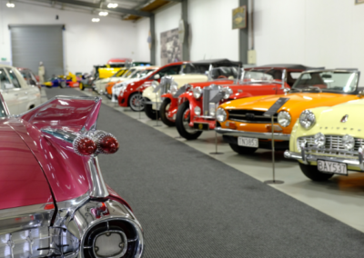 Cars park in a line at Nelson Classic Car Museum